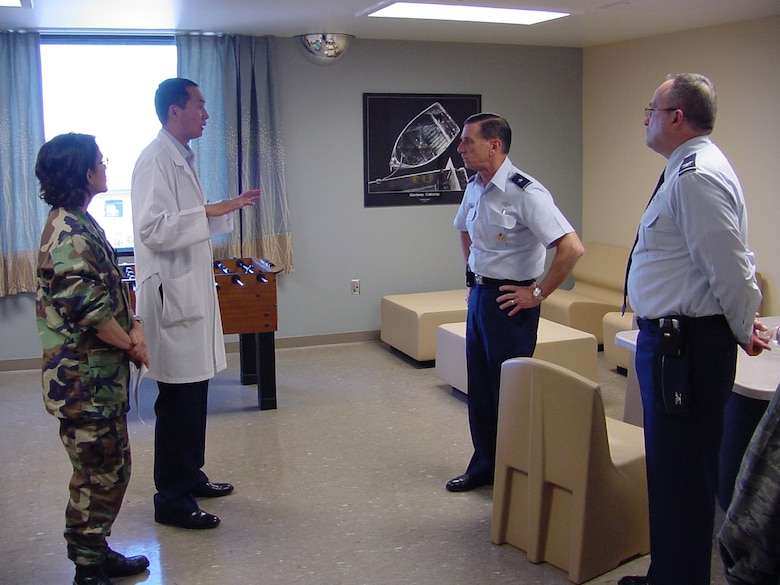 Maj. (Dr.) Vu Le, 60th Medical Operations Squadron medical director of the Joint Inpatient Mental Health Unit and Maj. Susan Von Eicken, 60th Inpatient Squadron nurse, brief Brig. Gen. (Dr.) Byron C. Hepburn, Air Force Medical Support Agency commander and Col. (Dr.) Lee E. Payne,  60th Medical Group commander on the new DoD/VA Joint Inpatient Mental Health Unit at David Grant USAF Medical Center.  General Hepburn, a former 60th Medical Group commander, has recently been selected to be deputy Surgeon General for the Air Force.  (U.S. Air Force photo / Jim Spellman)