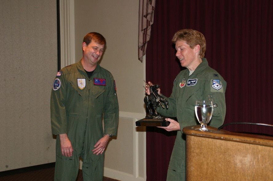 At the end of the conference, Col. Patricia Hoffman, commander, 552nd Air Control Wing, presented Maj. Gen. Stephen Schmidt, commander, NATO Airborne Early Warning Force, with an End of the Trail statue by James Earle Fraser as a token of appreciation for sponsoring the EMACC. Photo courtesy of 1st Lt. Blacke.