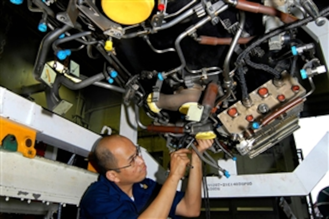 Us Department Of Defense Photos Photo Gallery Aerospace Wiring Harness Navy Petty Officer 1st Class James Gregorio Installs A On An F