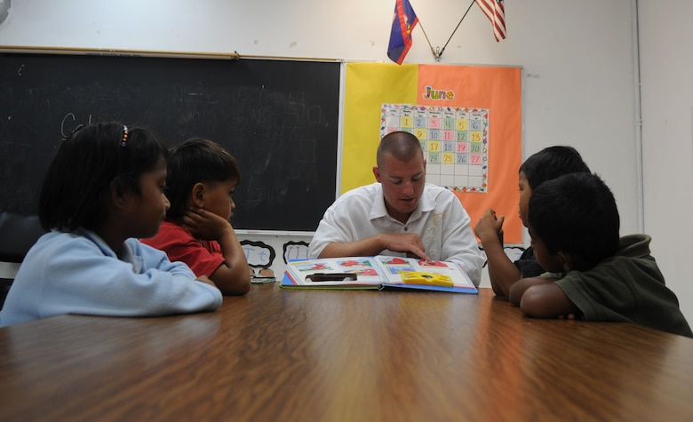 Elmendorf Airmen spend time with students during Andersen