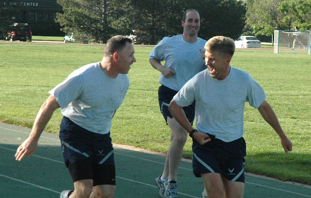 Maj. Alan Flolo, 302nd Airlift Wing executive officer (right), jokes with Chief Master Sgt. Rocky Hart during the June 14 'Get Fit with Leadership' run at the Peterson Air Force Base track in Colorado. Each Sunday during Unit Training Assemblies, or UTA weekends, members of the 302nd AW can come out to the base track and run with leadership. Members shoould report to the track no later than 7:30 a.m. Chief Hart is the 310th Space Wing command chief, based at local Schriever AFB. (U.S. Air Force photo/Tech. Sgt. Daniel Butterfield)