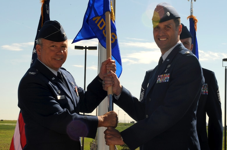 BUCKLEY AIR FORCE BASE, Colo. – Col. Michael Chyrek , 460th Medical Group commander, hands over  command of the 460th Medical Support Squadron to Lt. Col. Scot Spann, in a change of command ceremony outside the 460th Space Wing headquarters building, June 17.  Colonel Spann assumed command from Col. Kirsten Watkins and joins Team Buckley from Wright-Patterson AFB, Ohio.  (U.S. Air Force photo by Senior Airman Erika Brooke)