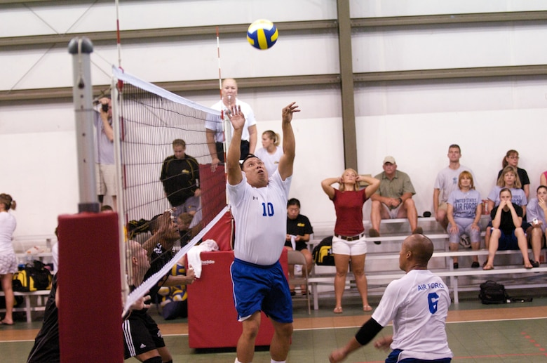Arizona Air National Guardsman Staff Sgt. Ray Valles sets the ball for Staff Sgt. Clarence Hucks from Yakota Air Base, Japan, at the Armed Forces Volleyball Championship at Marine Corps Air Station Cherry Point, N.C. The Air Force's men's team won first place during championship finals, June 10. (Courtesy photo by Kavika Lacar)