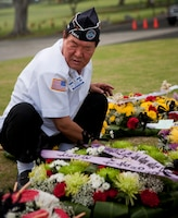 A Republic of Korea veteran arranges a wreath during the Korean War Memorial at the National Memorial Cemetery of the Pacific June 25. Hawaii lost more service members per capita in the Korean War than any other state. (Official U.S. Marine Corps photo by Lance Cpl. Achilles Tsantarliotis)(Released)