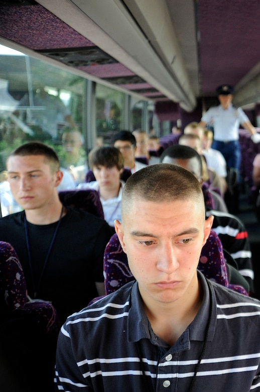 Basic cadets ride in a bus from Doolittle Hall to the cadet area at the U.S. Air Force Academy during cadet inprocessing at the U.S. Air Force Academy in Colorado Springs, Colo., June 25. More than 1,300 cadets were accepted to the Class of 2013 out of nearly 10,000 applicants. (U.S. Air Force photo/Mike Kaplan)