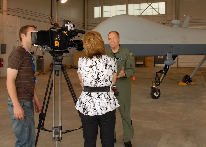 News 10 Now, Syracuse, Reporter Joleene Des Rosiers interviews New York Air National Guard, 174th Fighter Wing Commander, Col. Kevin W. Bradley in front of an MQ-9 Reaper Unmanned Aerial Vehicle at Hancock Field in Syracuse, NY, on 26 June 2009. Bradley was answering questions as part of the Media Day event introducing the new MQ-9 Reaper Unmanned Aerial Vehicle mission of the 174th Fighter Wing. (US Air Force photo by Tech. Sgt. Jeremy M. Call/Released)