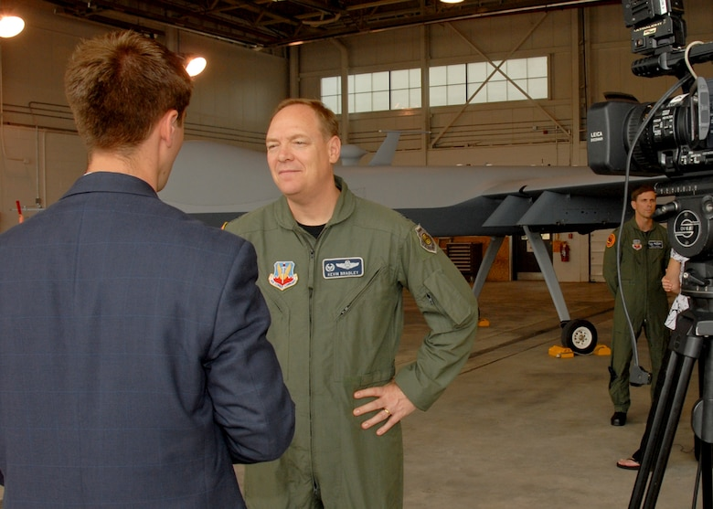 WTVH Multi-Media Journalist Joseph Roetz interviews New York Air National Guard, 174th Fighter Wing Commander, Col. Kevin W. Bradley in front of an MQ-9 Reaper Unmanned Aerial Vehicle at Hancock Field in Syracuse, NY, on 26 June 2009. Bradley was answering questions as part of the Media Day event introducing the new MQ-9 Reaper Unmanned Aerial Vehicle mission of the 174th Fighter Wing. (US Air Force photo by Tech. Sgt. Jeremy M. Call/Released)