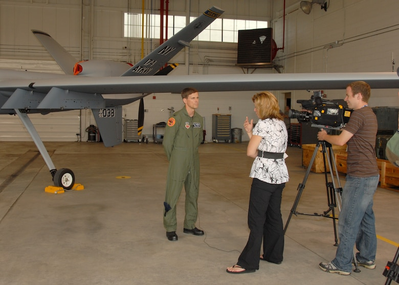 News 10 Now, Syracuse, Reporter Joleene Des Rosiers interviews New York Air National Guard, 174th Fighter Wing Operations Group Commander, Col. Greg Semmel in front of an MQ-9 Reaper Unmanned Aerial Vehicle at Hancock Field in Syracuse, NY, on 26 June 2009. Semmel was answering questions about the new  MQ-9 Reaper UAV mission of the 174th Fighter Wing. (US Air Force photo by Tech. Sgt. Jeremy M. Call/Released)
