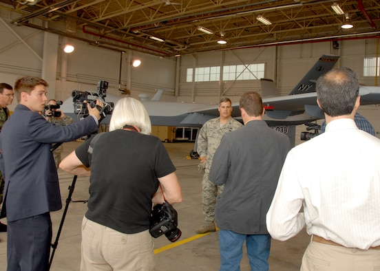 New York Air National Guard, 174th Fighter Wing Maintenance Group Commander, Col. John Balbierer talks about the MQ-9 Reaper Unmanned Aerial Vehicle to the local press at Hancock Field in Syracuse, NY, on 26 June 2009. The media was invited as part of the Media Day event introducing the new Unmanned Aerial System mission of the 174th FW. (US Air Force photo by Tech. Sgt. Jeremy M. Call/Released)