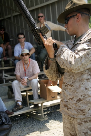 Members of the New England chapter of the Young Presidents Organization learn how to properly handle and fire the M16-A2 Service Rifle June 26. The business executives visited the Marine Corps through the Marine Corps Business Executive Forum. The semi-annual event gives chief executives the opportunity to learn about the Marine Corps firsthand.