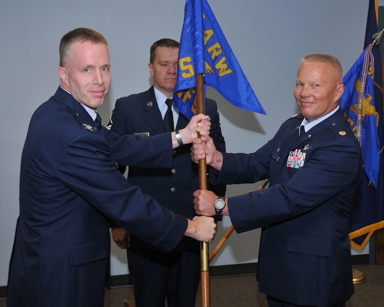 Col Kenneth L Gammon, 151st Mission Support Group commander, transfers the 151st Security Forces guidon to the new commander  Maj. David Todd Meyer during the change of command ceremony June 7 at Utah Air National Guard Base, Salt Lake City, Utah.U.S.Air Force photo by Tech Sgt Michael D Evans