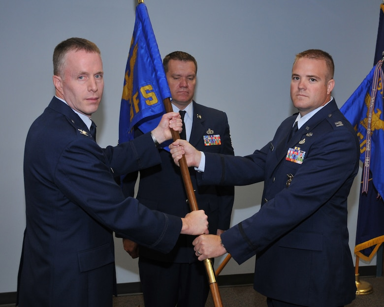 Col Kenneth L Gammon, 151st Mission Support Group commander, receives the 151st Security Forces guidon from Capt. Kevin K. Larsen during the change of command ceremony June 7 at the Utah Air National Guard Base, Salt Lake City, Utah. Captain Larsen is transferring to take command of the Weapons of Mass Destruction Civil Support Team at the armory in Lehi, Utah.