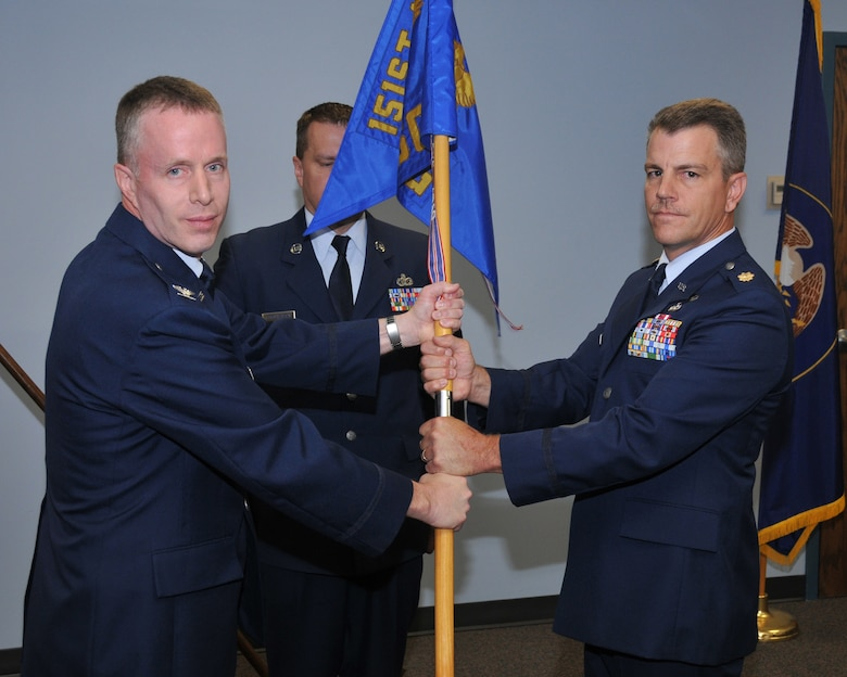 Col Kenneth L Gammon, 151st Mission Support Group commander, Utah Air National Guard, transfers the 151st Military Personnel Flight guidon to the new commander  Maj. Mark W. Roberts during the change of command ceremony June 7 at Utah Air National Guard Base, Salt Lake City, Utah.U.S.Air Force photo by Tech Sgt Michael D Evans