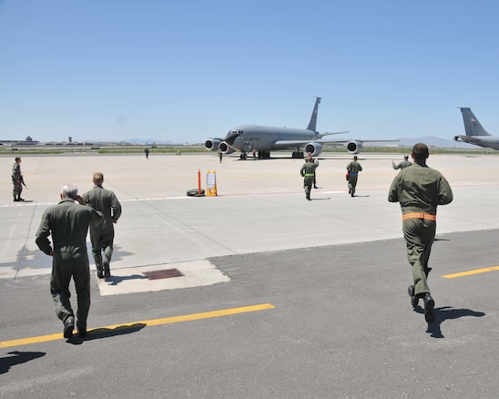 SALT LAKE CITY - Members of the 191st Air Refueling Squadron run to their aircraft June 27 as part of the wing?s participation in the Global Thunder exercise.  Global Thunder is U.S. Strategic Command?s major nuclear exercise that includes command post activities as well as force generation and flying operations. The 151st ARW's nuclear support mission includes air refueling of flying assets.  U.S. Air Force photo by Tech. Sgt. Michael D Evans.
