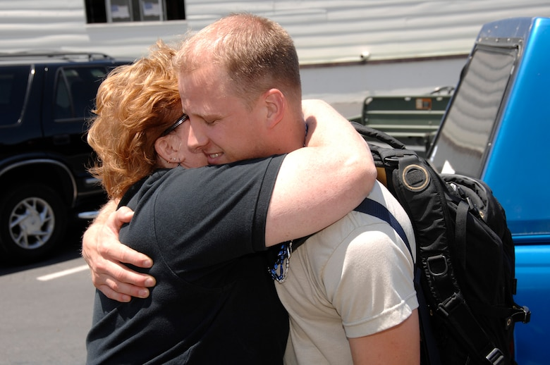 Senior Airman James Parmentier, an aircraft maintenance specialist from the 129th Maintenance Group, is welcomed home at Moffett Federal Airfield, Calif., after a 40-day deployment to Djibouti June 13. (Air National Guard photy by Master Sgt. Dan Kacir)(RELEASED)