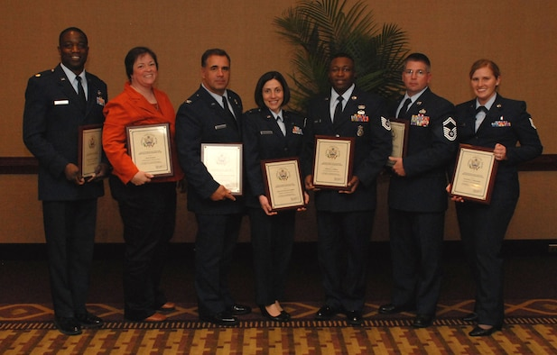 NIAGARA FALLS AIR RESERVE STATION, N.Y. - From left:  Maj. Patrick Campbell, Mrs. Beth Greaser, Col. Terry Lawrence accepting for Lt.Col. Samuel Bellia, 1st Lt. Gina Pizziconi-Cupples, Tech. Sgt Marvin Holmes, Senior Master Sgt. Roger Rozon and Tech. Sgt. Victorine Cleaveland, all members of the 914th Airlift Wing, are recipients of the Excellence in Government Awards given May 5, 2009.  (U.S. Air Force photo by Senior Airman Stephanie Clark)