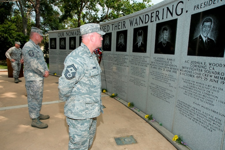 EGLIN AIR FORCE BASE, Fla. -- On the 13th anniversary of terrorist bombing of Khobar Towers bombing, members of the 33rd Fighter Wing gathered June 25 to honor the lives of fallen comrades.  Joined with their commander and visiting surviving family members, they laid flowers and a wreath during a short ceremony at the memorial on Nomad Way here. On the night of June, 25 1996, in Saudi Arabia, 12 of the 19 Airmen who lost their lives during the bombing were deployed from the 33rd FW.  They represented a cross-section of the wing as crew chiefs, expeditors, weapons loaders, mechanics, production superintendents, program managers, and technicians. (U.S. Air Force Photo/Mike Fleck)