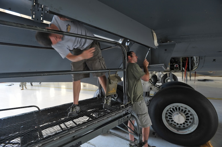 "Tech. Sgt. Adam Keeter (on left) and Tech. Sgt. Seth Cullum work together to replace a seal at the bottom of a KC-135 Stratotanker in a hangar at McConnell Air Force Base, Kan. They are part of a ""blended"" Reserve and active-duty team preparing for Air Mobility Rodeo 2009. Sergeant's Keeter and Cullum work for the 931st Aircraft Maintenance Squadron at McConnell as air reserve technicians, full-time civilian employees who work in the same position they occupy as Reservists. (U.S. Air Force photo/Tech. Sgt. Jason Schaap)"
