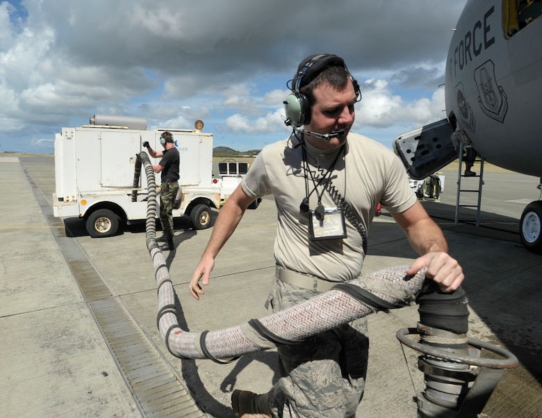 Staff Sgt. Scott Perkins carries an air hose to a KC-135 Stratotanker at an airfield in St. Croix, U.S. Virgin Islands. The tanker was being prepared to depart for the end of a three-day aeromedical evacuation training mission supported by the 931st Air Refueling Group. Sergeant Perkins is a crew chief assigned to the 931st Aircraft Maintenance Squadron. (U.S. Air Force photo/Tech. Sgt. Jason Schaap)