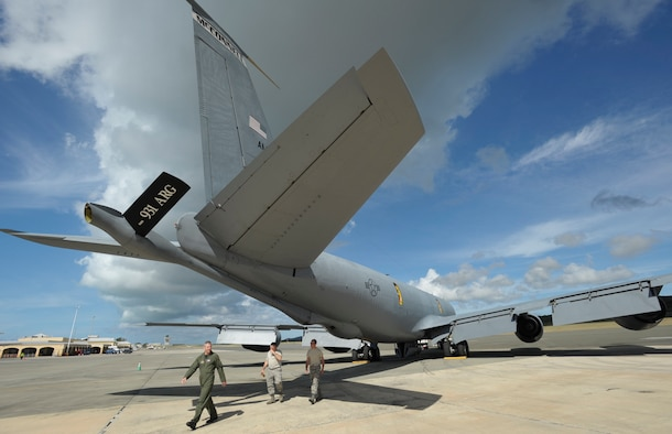 Master Sgt. Paul McGinnis and Senior Airman Alan Cooper (at right) follow Lt. Col. Keith Kontz while inspecting a KC-135 Stratotanker before departing from St. Croix, U.S. Virgin Islands on March 1. Aeromedical evacuation training missions to St. Croix allow pilots to complete overseas training requirements. Colonel Kontz is a Reserve KC-135 pilot assigned to the 18th Air Refueling Squadron, the flying unit of the 931st Air Refueling Group at McConnell Air Force Base, Kan. Both Sergeant McGinnis and Airman Cooper are Reservists assigned to the 931st Aircraft Maintenance Squadron. (U.S. Air Force photo/Tech. Sgt. Jason Schaap)