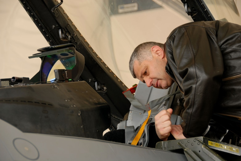 Brig. General Mirko Vranic of the Serbian Air Forcelooks at the cockpit of an F-16 Fighting Faclon at the 180th Fighter Wing, Ohio Air National Guard on Jan. 26. Four members of the Serbian Armed Forces General Staff participated in a familiarization visit at the 180th Fighter Wing as part of the Ohio National Guard State Partnership Program.  The primary purpose of the visit was to help them understand how their U.S. Fighter Wing counterparts operate. Ohio began its partnership with the Republic of Serbia in 2006.