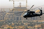 A UH-60 Black Hawk helicopter flies over a mosque during a routine flight in Baghdad, Iraq, Feb. 27, 2009. The helicopter crew is assigned to 1st Battalion, 244th Assault Helicopter Battalion.