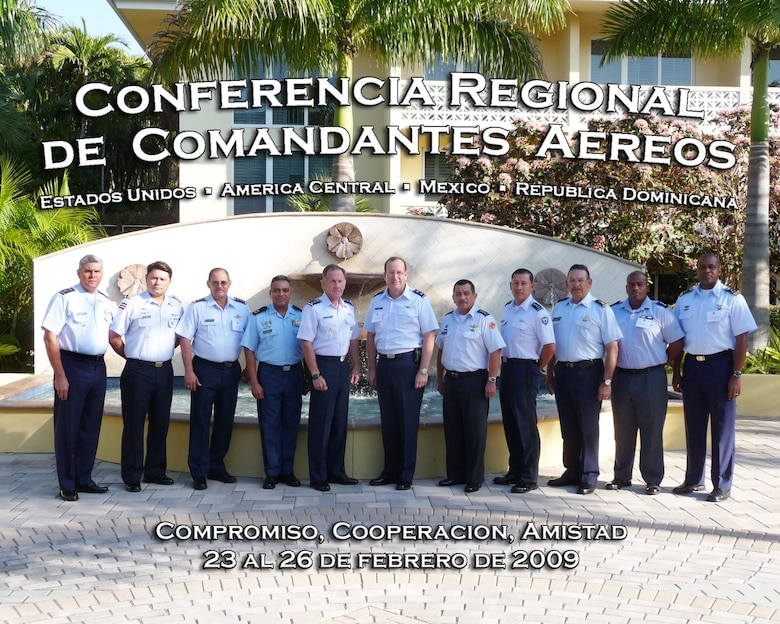 "MIAMI, Fla. -- Central American air chiefs attending the Regional Air Chiefs Conference in Miami, Fla., pose for a photo.  The key phrases in the graphic are ""Partnership,"" ""Cooperation"" and ""Friendship.""(U.S. Air Force graphic illustration by Capt. Anabelle Cabreja)"