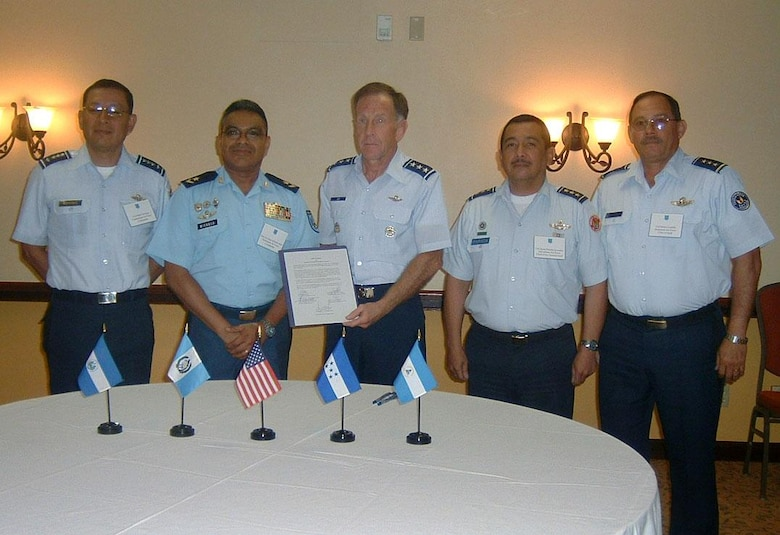 MIAMI, Fla. -- (From left to right) Colonel Pedro Noriega Cuellar of Guatemala, Brigadier General Jorge Miranda Jaime of Nicaragua, Lt. Gen. Norman Seip of 12th Air Force (Air Forces Southern), Colonel Jaime Parada Gonzalez of El Salvador, and Colonel Marco Castillo Brown of Honduras stand for a photo after signing the Regional Aircraft Modernization Program Feb. 24.  RAMP was one of many topics discussed during the Regional Air Chiefs Conference in Miami. (U.S. Air Force photo by Tyrone Barbery)