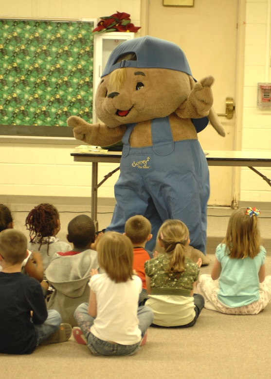 """Sammy the Rabbit"", co-created by Mr. Sam Renick, children's author, educates children at the Primary School, Feb. 26, at Holloman Air Force Base, N.M., on saving money early. Mr. Renick visits numerous military installations to speak to children about getting in the habit of saving money early. (U.S. Air Force photo/Airman 1st Class Rachel A. Kocin)"