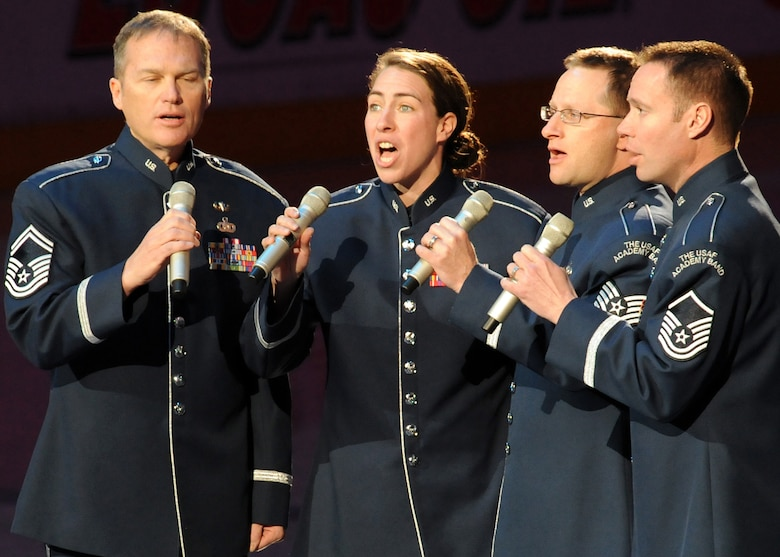 """Members of the USAFA Band perform God Bless America and the National Anthem at the Staples Center in Los Angeles, Calif., before the LA Kings play the Phoenix Coyotes, Feb 21. """"Blue Steel"""" is a component of the United States Air Force Academy Band that performs popular music to enhance community relations and support the recruiting mission of the U.S. Air Force.  (Photo by Atiba S. Copeland)"""