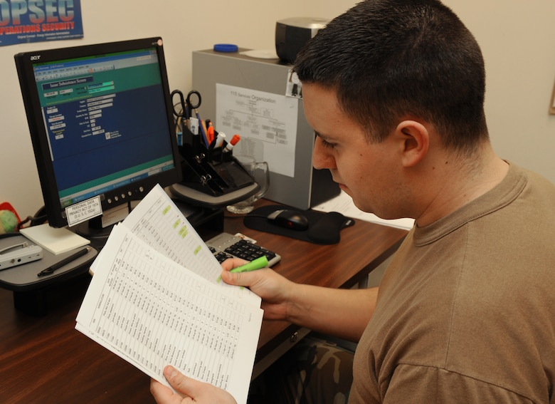 Staff Sgt. Scott Zautke, 115th Services Flight, reviews an inventory listing to ensure there will be enough food ordered to feed the unit at future UTAs. Preparing meals in advance for more than 1,000 Airmen can be a daunting task, but its something that the 115 SVF is used to doing month-to-month. (U.S. Air Force photos by Master Sgt. Paul Gorman)