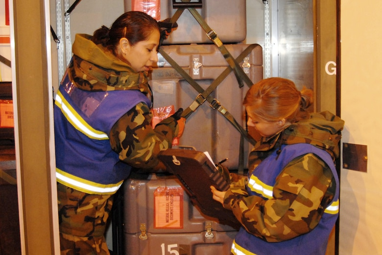 MSgt Lisa Brandfas and SSgt Jennifer Neville  from TMO (Traffic Management Office) process cargo inside an ISU (Individual Storage Unit) shipping container during a Phase 1 Operational readiness Inspection at the 140th Wing.  MSgt Brandfas is an augmentee from the 140th Wing's Contracting section that is helping out in another area because her area is not inspected during this phase.