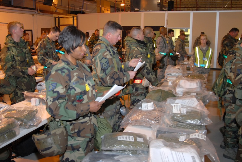 SSgt Terry Baron, SrA Gregory Swaisgood, MSgt Mark Caton, SSgt Troy Lippelt, SSgt Richard Martinez and others inventory their C-bags as SSgt Vicky Perreault observs during an Operational Readiness Inspection at the 140th Wing.  This is part of the processing that is required as  members prepare to deploy.  (Photo by SMSgt John Rohrer, 140th Wing Public Affairs)