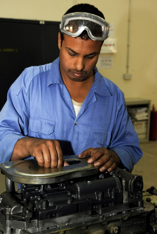 An Iraqi army member works on putting together the transmission for a M1114 HMMWV March 4 at Taji, Iraq. The transmission shop is one of many steps used to totally overhaul a new HMMWV at the Taji national maintenance depot for the Iraqi army. (U.S. Air Force photo/Senior Airman Jacqueline Romero)