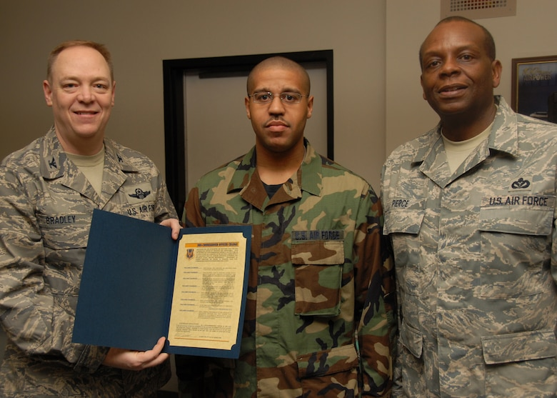 US Air Force Colonel Kevin Bradley and US Air Force New York State Air National Guard Command Chief Master Sergant Hardy Pierce Jr.  present to US Air Force Staff Sergant Robert Fugate a certificate recognizing his recent promotion at the 174th Fighter Wing in Syracuse New York.   US Air Force Photo by SSgt Ricky Best
