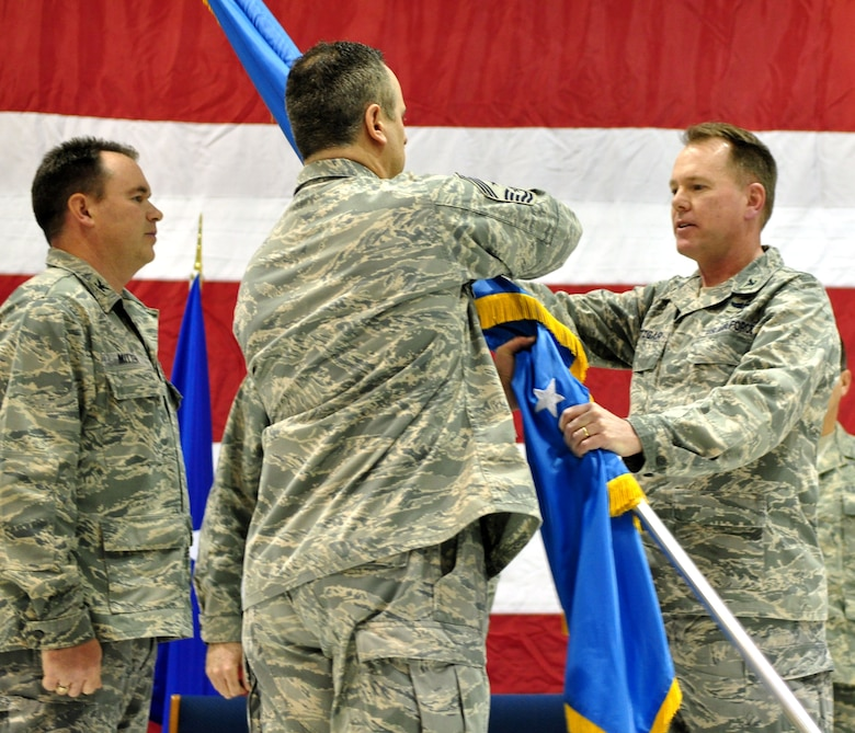 Command Chief Master Sgt. Joseph Parlato (center) hands over control of the 128th Air Refueling Wing's Flag to the new commander, Col. Edward E. Metzgar (right) in the South Dock of Milwaukee, Wisconsin on Saturday, March 07, 2009. Col Murry Mitten (left) looks on after relinquishing command of the Wing. (US AF Photo By: SSgt Jeremy Wilson)
