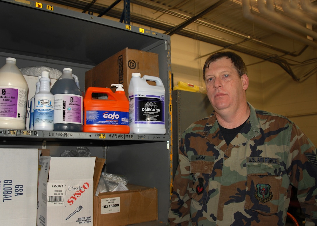 US Air Force Technical Sergeant Michael D Lucak is displaying some of the green seal approved chemicals that the 174th Fighter Wing in Syracuse NY is using on the base. TSgt Lucak was approved to purchase a new One Solution chemical dilution system that is going to save the base money and time.