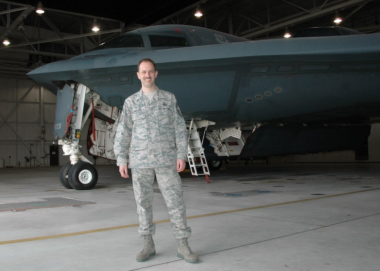 Chief Master Sgt. Jeffrey Schneider stands in front of a B-2 Stealth Bomber.  Schneider was selected as the 509th Operations Group and the 131st Operations Group Air Crew Flight Equipment Superintendent. He leads both the Air National Guard and Active Duty operations via Total Force Integration. (Photo by MSgt. Mary-Dale Amison)