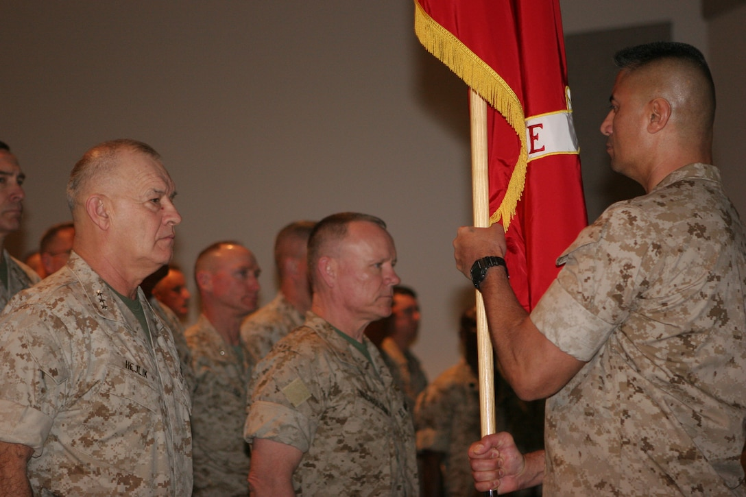 Sgt. Maj. Ernest Hoopii, 2nd Marine Expeditionary Brigade sergeant major, presents the 2nd MEB colors to Lt. Gen. Dennis J. Hejlik (left) during the brigade's assumption of command ceremony March 9.   Brig. Gen. Larry Nicholson received the colors from Hejlik, symbolizing the authority and accountability of command vested in Nicholson by naming him the 2nd MEB commanding general.