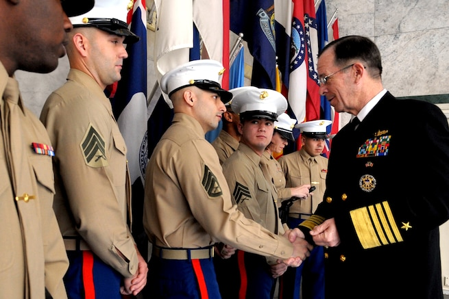 U.S. Navy Adm. Mike Mullen, chairman of the Joint Chiefs of Staff, greets Marine Security Guard team members at the U.S. embassy in Mexico City, Mexico, March 6, 2009. The chairman visited the country to meet with senior Mexican officials and discuss ongoing U.S. and Mexican relations.