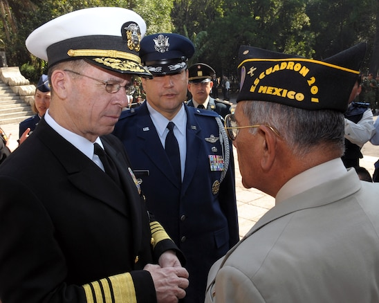 U.S. Navy Adm. Mike Mullen, chairman of the Joint Chiefs of Staff, talks to a former 201st Fighter Squadron member at Chapultepec Park in Mexico City, Mexico, March 6, 2009.