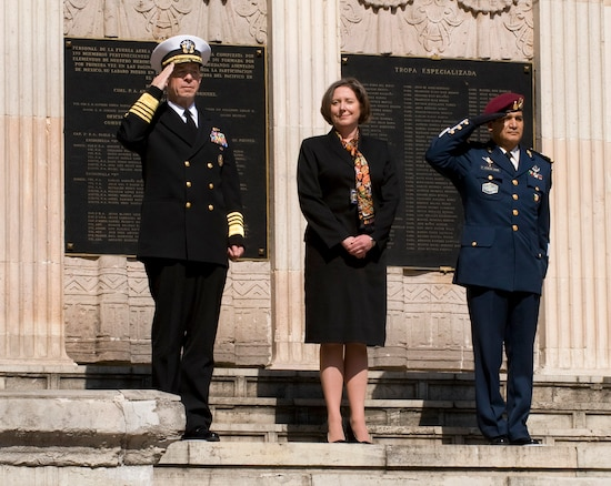 U.S. Navy Adm. Mike Mullen, chairman of the Joint Chiefs of Staff, U.S. Charge' de Affaires to Mexico Leslie Bassett and Mexican army Brig. Gen. Pedro Escalera Cobian render honors during a tribute to the 201st Fighter Squadron at Chapultepec Park in Mexico City, Mexico, March 6, 2009. The chairman laid a wreath at the 201st memorial and talked with former squadron members, who deployed with U.S. forces to the Philippines during World War II.