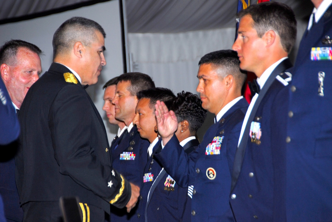 Tech. Sgt. Michael Brizuela, Outstanding Honor Guard Member of the Year from the 162nd Fighter Wing, salutes Maj. Gen. Hugo Salazar, Arizona Adjutant General at the Arizona Air National Guard's Outstanding Airman of the Year banquet March 7.  (Air National Guard photo by Staff Sgt. Sarah Elliott)
