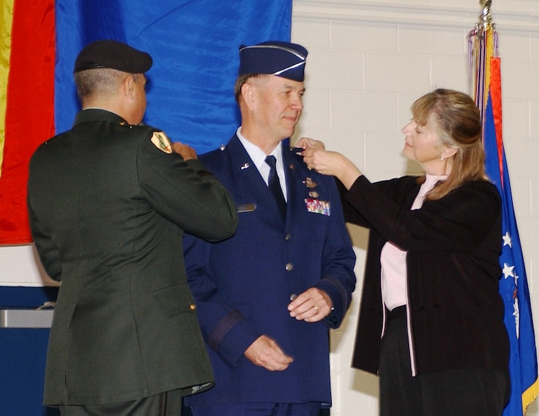 Maj. Gen. Rick Moisio (center) has his second star pinned on by Maj. Gen. Hugo Salazar, Arizona Adjutant General, and his wife Mary. General Moisio, the former 162nd Fighter Wing commander, will serve as the next deputy director of the Air National Guard. (Air National Guard photo by Staff Sgt. Sarah Elliott)