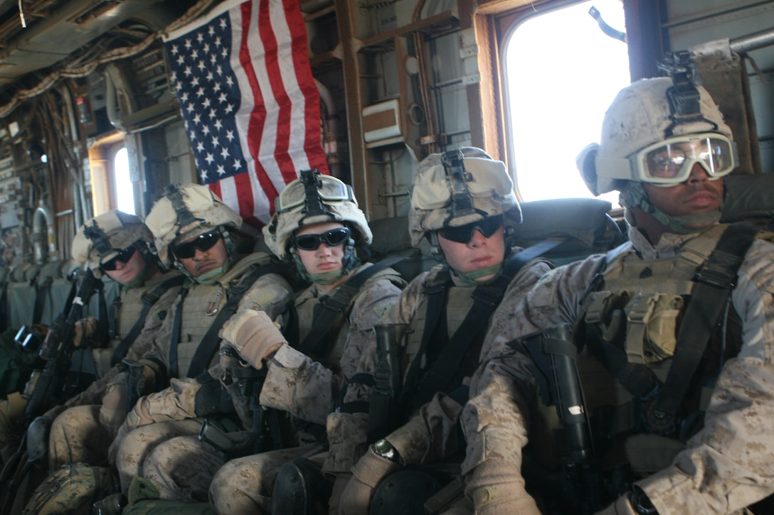 Marines from Multi National Force-West's Quick Reaction Force wait to exit a CH-53E helicopter during a quick reaction exercise at Camp Ripper, Iraq.  Marines from Bravo Company, 1st tank Battalion, Regimental Combat Team 8, assume responsibilities of the QRF March 12, 2009.