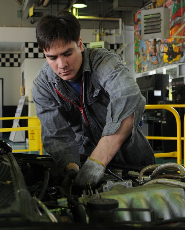 YOKOTA AIR BASE, Japan -- Staff Sgt. Alfred Domingo, 374th Maintenance Operations Squadron system controller, prepares to change out his vehicle's engine March 11 at the auto hobby center. (U.S. Air Force photo/Airman Devin Doskey)