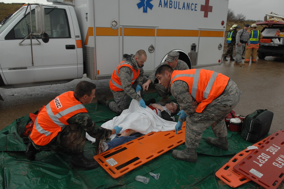 WHITEMAN AIR FORCE BASE, Mo. - Members of Team Whiteman's emergency responders prepare to transport a simulated tornado victim during the Major Accident Response Exercise March 10. The MARE focused on natural disaster preparedness and response for Whiteman and local community emergency responders. (U.S. Air Force photo/Staff Sgt. Charles Larkin)