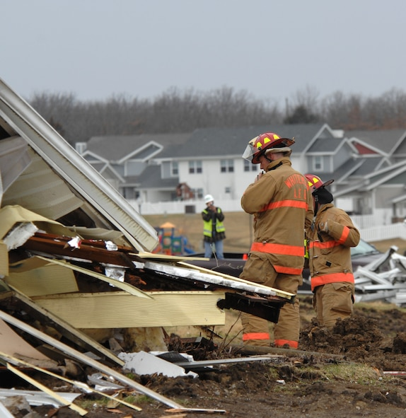 WHITEMAN AFB Mo. –  Members of the Whiteman and Sedalia fire departments perform search-and-rescue operations for victims within the rubble from an imploded house during the Major Accident Response Exercise March 10. The MARE exercise encompassed all base facilities and personnel with the exception of Whiteman Elementary School.  In coordination with the Army Corps of Engineers, the 509th Bomb Wing Plans and Scheduling office used an old base housing unit that was scheduled for demolition to give emergency responders real-world experience of a house that has been hit by a tornado. This exercise was a community joint effort for disaster relief. (U.S. Air Force photo/Staff Sgt. Charles Larkin)
