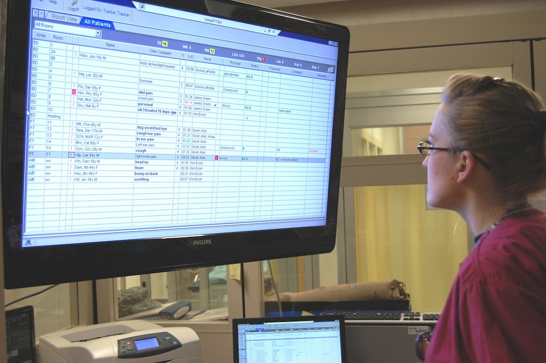 Capt. Sarah Abel, an emergency room nurse, reviews the patient status board.  (U.S. Air Force photo by Steve Pivnick)