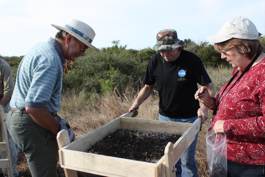 (left to right) Dale Hawkins, Timothy Kozusko and Elaine Williams sift through dirt and stones for artifacts at the Little Midden archeological site at Cape Canaveral Feb. 27. (U.S. Air Force photo/Airman 1st Class David Dobrydney)